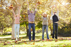 Family Throwing Autumn Leaves In The Air Royalty Free Stock Image