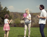 Family throwing ball to each other in the park Stock Photos
