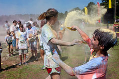 Family Throws Colored Corn Starch At Bubble Palooza Event Stock Image