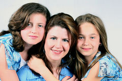 Family Ties. Closeup of mother and 2 daughters isolated on white Royalty Free Stock Image