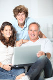 Family time. Family at home with laptop computer royalty free stock photos