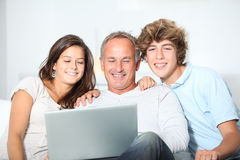 Family time. Family at home with laptop computer royalty free stock images