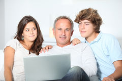 Family time. Family at home with laptop computer stock photography