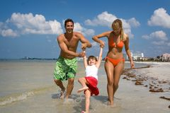 Family time. Happy family having good time on a beach