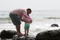 Family Time. Father and Daughter on the rocks at the beach Royalty Free Stock Photo