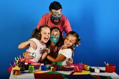 Family time and art concept. Artists create artwork and hug. Family and art concept. Artists create artwork and hug on blue background. Children and parents have stock image