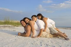 Family time on a beach stock photo