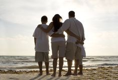 Family time on a beach. Happy family having good time on a beach Stock Photo