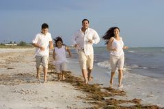 Family time on a beach stock photography