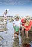 Family time at the beach Stock Photography