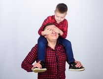Family time. Best friends. Father little son red shirts family look outfit. Child riding on dads shoulders. Happiness. Being father of boy. Having fun. Fathers stock photography