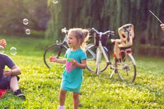 Free Family Time- Cheerful Girl Chase Bubbles In Nature Royalty Free Stock Photos - 122925798