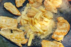 Family time - chicken meat and potato being grilled in a barbecue. Family time - juicy chicken meat and potato being grilled in a barbecue stock photo