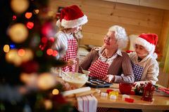 Family time- Grandmother and grandchildren making cookies. Family time- Grandmother and grandchildren making Christmas cookies stock photos