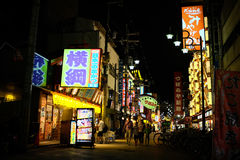Family time in night street view, Osaka, Japan. Osaka, Japan - August 05, 2014 : The tourist is walking with their family looking for some restaurant for their Royalty Free Stock Images