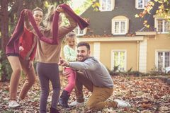 Family time, parents have play with children. Young cheerful family Royalty Free Stock Photography