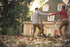 Family time, parents playing outside with children. royalty free stock image