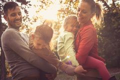 Family time , parents share love with children. Stock Photo