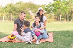 Family time portrait teen family in park.  Stock Photography