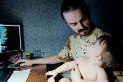 Family time spending at evening. father talking with little baby daughter in lamp light. Family time spending at evening. father talking with little baby stock photo