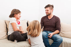Family time with young father and beautiful daughters. In the living room Royalty Free Stock Photos