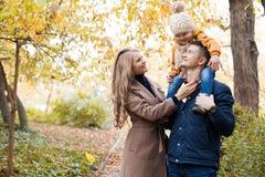 Family to boys walk on autumn Woods Stock Photos