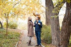 Family to boys walk on autumn Woods Royalty Free Stock Image