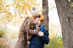Family to boys walk on autumn Woods stock images