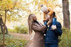 Family to boys walk on autumn Woods royalty free stock photo