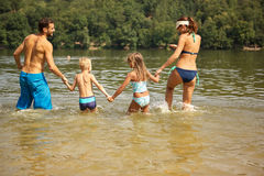 Family with to kids bathing Royalty Free Stock Images