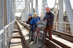 A family  to ride a bike. A family of 4 to ride a bike Stock Image