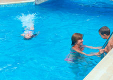 Family to swim in the pool. Royalty Free Stock Photos