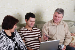 Family to view a laptop Stock Photos
