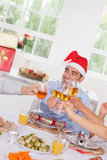 Family toasting at Christmas Stock Images