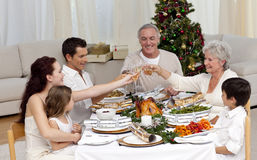 Family toasting in a Christmas dinner. At home Royalty Free Stock Photo