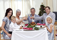 Family toasting in a Christmas dinner. At home Stock Photo