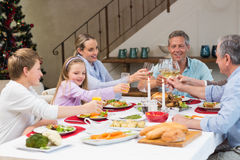 Family toasting with white wine in a christmas dinner Royalty Free Stock Photography