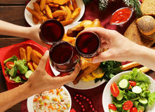 Family toasting wine glasses and having Christmas dinner. Family toasting red wine glasses and having Christmas dinner Stock Photo