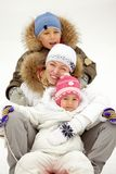 Family tobogganing Stock Photography