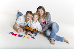 Family with a toddler is playing on the floor Stock Photography