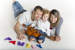 Family with a toddler is playing on the floor Stock Image