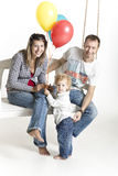 Family with a toddler is on a swing Stock Photography