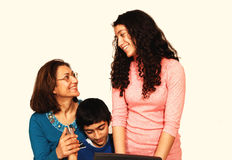 Family together. A mother with daughter and son sitting on the floor and having a very Stock Photos
