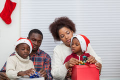Family together assembling gift stock images