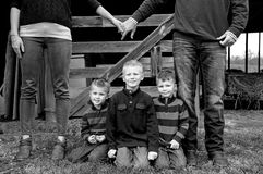Family together on farm black and white Royalty Free Stock Photography