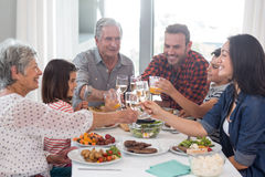 Family together having meal stock images
