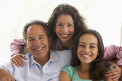 Family Together At Home. Teenage Family Together At Home Royalty Free Stock Image