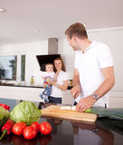 Family Together in Kitchen Stock Image