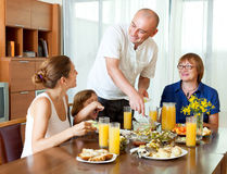 family together over  dining table Stock Images