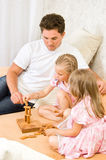 Family together playing Royalty Free Stock Photos